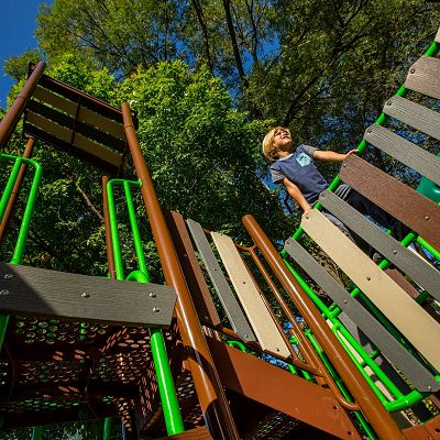 Blend your outdoor playground equipment into nature with theming options including Rock Climbers and Timber decks.