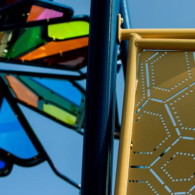 Add an outdoor play structure with ShadowPlay panels to let nature add colors.