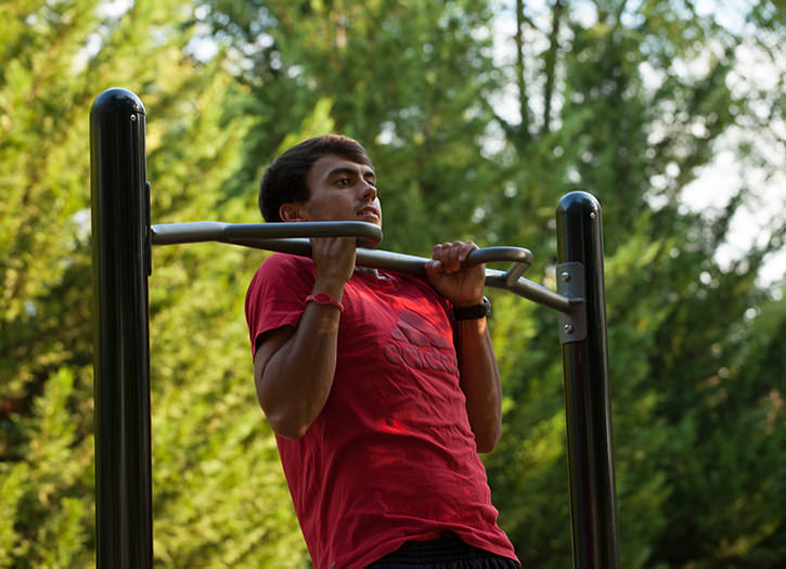 The Chin Up outdoor gym equipment helps increase muscular health.
